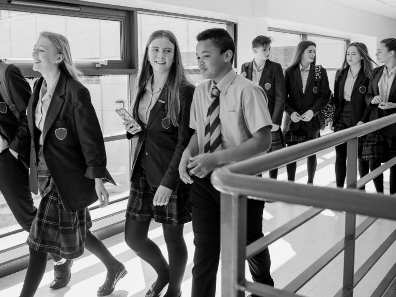 children walking in school corridor