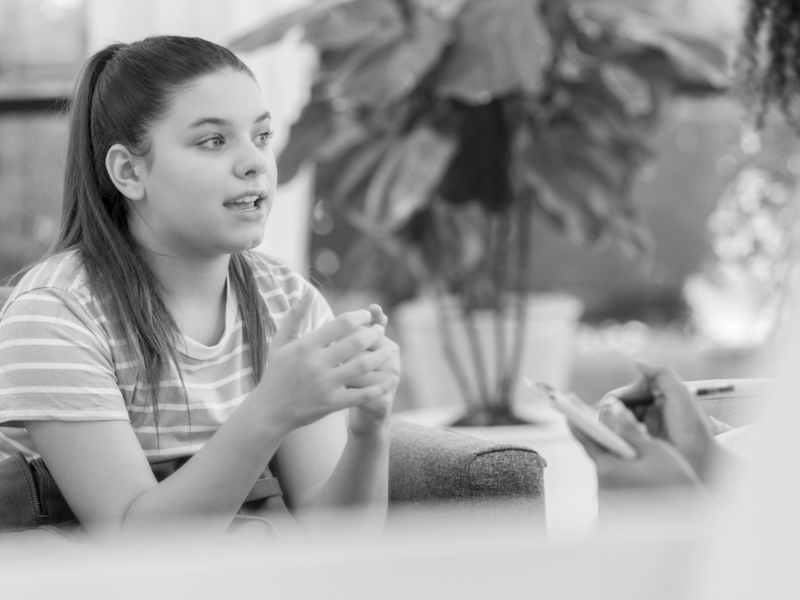 Girl talking to teacher